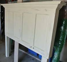 distressed old door headboard painted popcorn white then distressed with um gray by vine headboards
