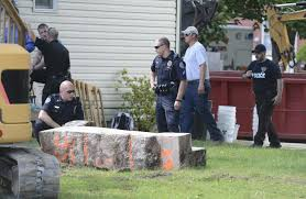 basement 911 pennsylvania. police officers look over a slab of concrete pulled out the basement home 911 pennsylvania