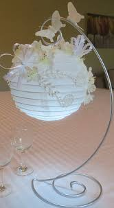 paper lanterns decorated with silk flowers by