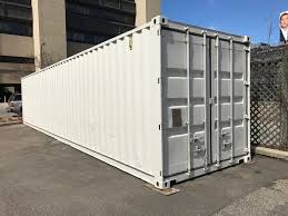 You can also use an industrial lubricant on the hinges and work the doors  back and forth for a few minutes to loosen them up... shipping container ...