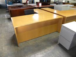 used mayline brand realoffice series l shaped veneer executive desk with fluted edges and double locking pedestals