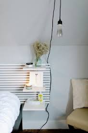 wall mounted shelves by the bed