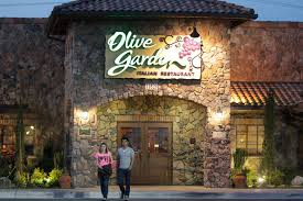 a promotion at olive garden allows customers to wolf down all the pasta salad bread and coca cola brand soft drinks they can in a