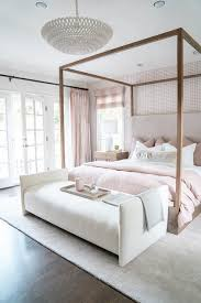 wooden canopy bed with light gray