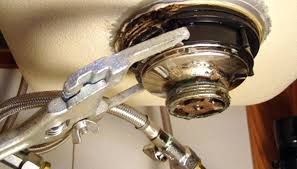 install a kitchen sink remove old basket from the sink install kitchen sink drain plumbers putty