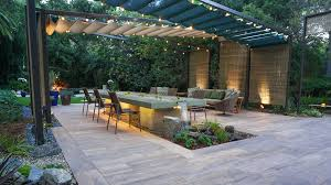 porcelain pavers provide stage for concrete water table installation turf