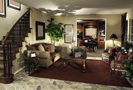 cheap elegant furniture. this cozy living room setup stands beneath the carved wood and wrought iron stair railing at cheap elegant furniture