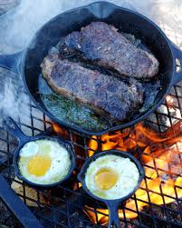 Image result for steak and beer on a campfire