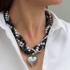 pale pink murano heart statement necklace black diamond version being worn