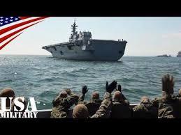 「護衛艦ひゅうがに手を振る空母ロナルドレーガンの米兵」の画像検索結果