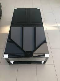 dwell black glass chrome coffee table