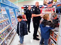 Cops swap badges for bags in annual shopping spree | Local | tdn.com