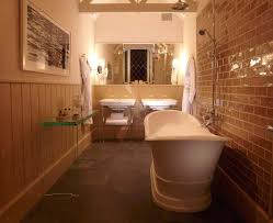 deep soaking tub with shower. exposed brick walls glass tables deep soaking tub and shower in the spring cottage54 5 x with w