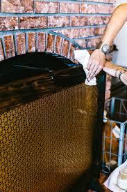 a diy fireplace screen using a cool radiator screen nice modern lines