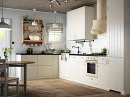 An off-white country kitchen with black worktops. Combined with off-white  oven