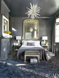make a room feel bigger and brighter with an oversize mirror a large mirror hangs