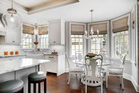 round table breakfast nooks white marble countertop kitchen cabinet chandelier lamp white cabinet raised cabinet ceiling