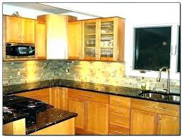 kitchen backsplash ideas with uba tuba granite countertops