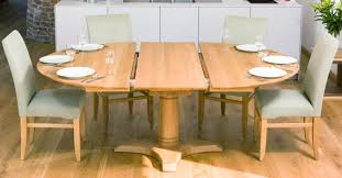 when closed this round pedestal table size and design will seat 6 8 extending to seat up to 10 people