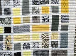 yellow and gray animal print baby quilt
