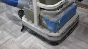 sanding a parkay floor with an upright random orbit sander