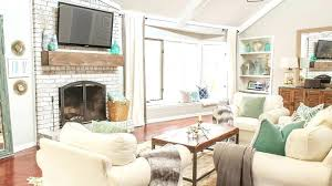living room with tv over fireplace over fireplace ideas spaces