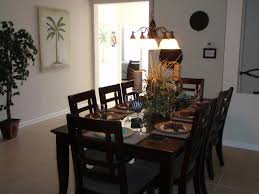 8 seater dining table with rough tile flooring and chandelier over with regard to 8 seater