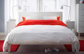 modern ikea bedroom white with red accents