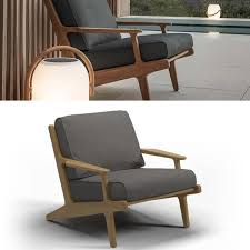 a smooth buffed teak frame and deep textured sunbrella outdoor cushions this outdoor lounge complements the bay collection of outdoor relaxing chairs
