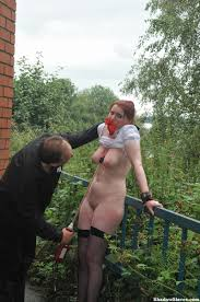 Submissive female suffers humiliation outdoor