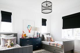 charcoal gray twin beds with trundle and orange and black plaid blankets