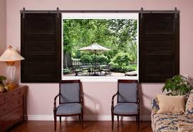 sliding barn door shutters are perfect for windows with space on both sides for the door panels to slide open the customized look of barn doors is truly a