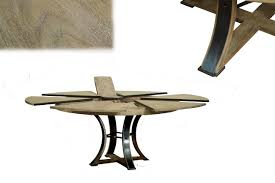 transitional gray oak round jupe table with self storing leaves seats 4 to 8 people