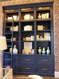 street of dreams arizona via annie vincent interiors incredible home office with graphic grasscloth wallpaper framing a navy blue built in bookcase