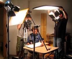 lighting set. students set lights for a 16mm film shoot lighting n