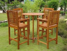 image of wooden outdoor chairs and round table