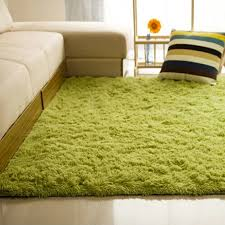living room floor mat medium green fluffy floor mat wooden panel white leather sectional couch with