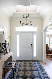 Traditional and timeless finish work in this stunning entryway ...