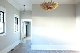 light grey walls white trim gray and white walls living room light gray walls grey gold chandelier black window sashes whitewashed gray and white walls very