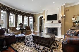 traditional family room furniture layout ideas with fireplace and wall mounted tv also brown leather sofa set