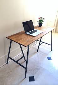 this wood desk or rustic table on gray steel ikea legs which are included at