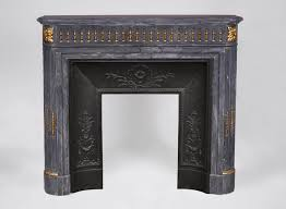 beautiful antique louis xvi style fireplace with rounded corners in blue turquin marble and gilt bronze ornaments