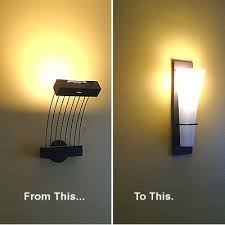 a wall mounted light fixture sconce