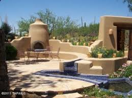 new mexico patio ideas. an enclosed southwest design style patio with outdoor fireplace and shelf seating attached to color new mexico ideas