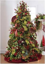 Colour-coded in traditional colours, this ribboned tree has a Victorian  feel. I like the red fabric wrapped around the base-its a good idea to  cover the ...