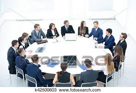 business conference business meeting business people in formalwear discussing something while sitting together at the round table