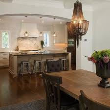 chain chandelier with wood dining table