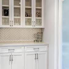 white butler pantry with white herringbone tile backsplash