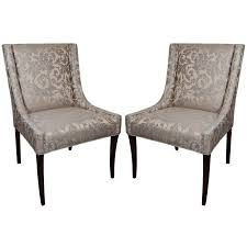 pair of elegant upholstered occasional chairs with high back design
