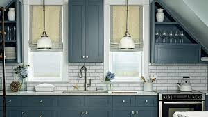 blue and gray kitchen a wall of steely blue cabinetry paired with white pendant lights and